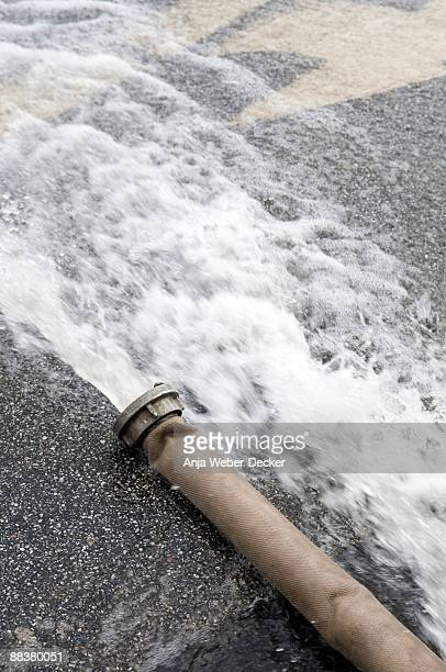 Water flowing through fire hose, elevated view, close-up