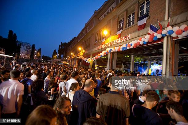 firehouse dances on bastille eve in paris - bastille day stock pictures, royalty-free photos & images