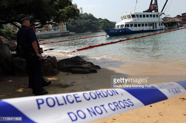 Fireman and police inspect the badly damaged Lamma IV passenger boat after the fatal collision on 1 OCT which killed 38 people Pictured at Nga Kau...