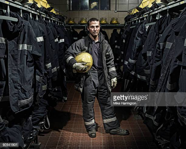 fireman at fire station - firefighter stock pictures, royalty-free photos & images