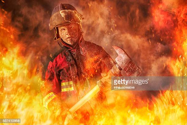 fireman caught in a fire - firefighter stock pictures, royalty-free photos & images
