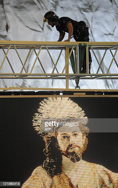 A fireman checks the stage while Pope Benedict XVI leads a Prayer Vigil at the Cuatro Vientos air base in Madrid on August 20 2011 during the World...