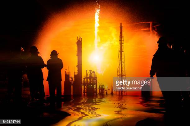Fireman  , concept crisis a large oil refinery fire and emergency fire case.