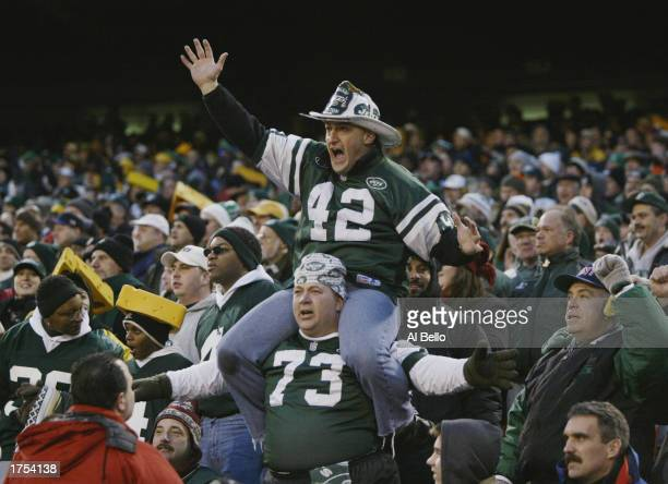 Fireman Eddie leads the fans in a J.E.T.S. Chant during the NFL game between the Green Bay Packers and the New York Jets at Giants Stadium on...