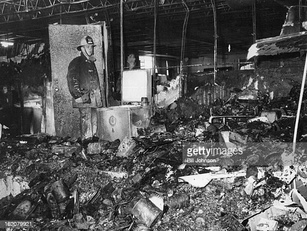 DEC 5 1968 DEC 6 1968 Fireman Fred Larson stands near ceramic Kiln believed Responsible for fire at Meritt Hutton School in