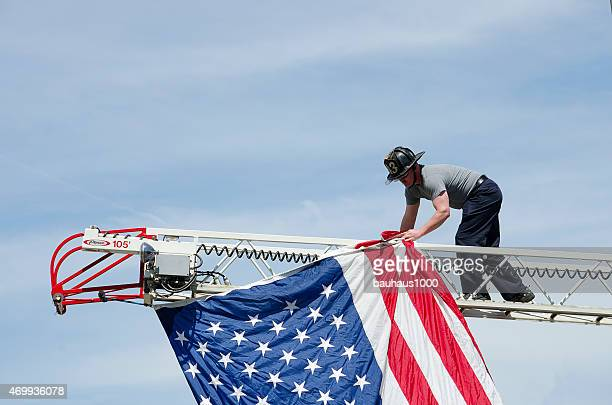 Fireman hanging a flag in a Patriotic Parade