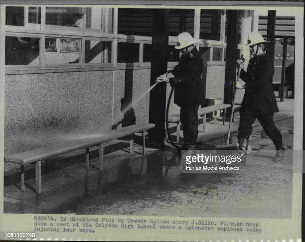 Fireman hose down a seat at the Colyton High School where a detonator exploded today injuring four daysFour boys were injured two seriously by a...