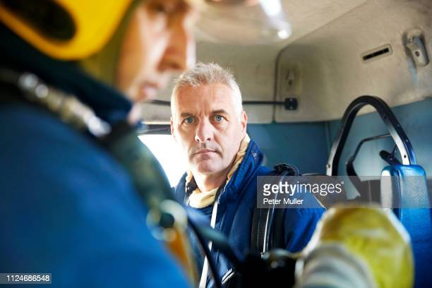 fireman inside fire engine - firefighter stock pictures, royalty-free photos & images