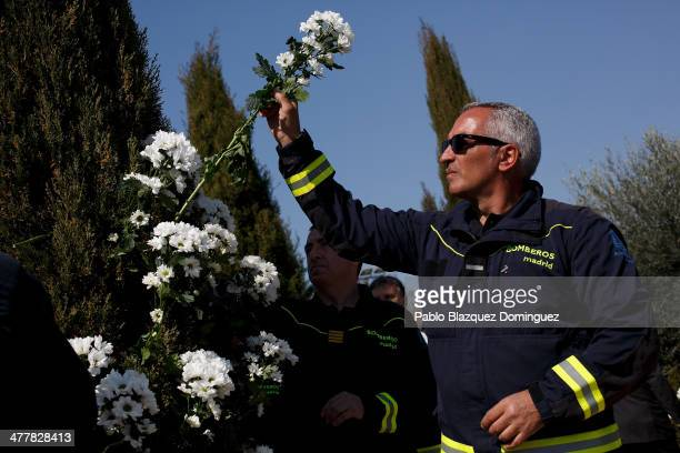 A fireman leaves flowers at the Forest of the Absent in memorial for the victims of Madrid train bombings during the 10th anniversary on March 11...