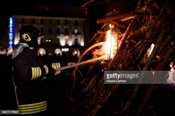 A fireman lights the fire during the annual bonfire of the Waldensian Evangelical Church to celebrate the conquest of civil and political rights...