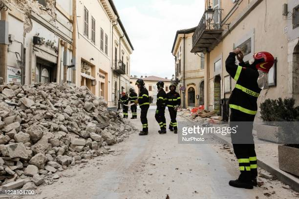 Fireman ltakes a photo at a destroyed houses in Norcia, Italy, Italy, on November 1, 2016.