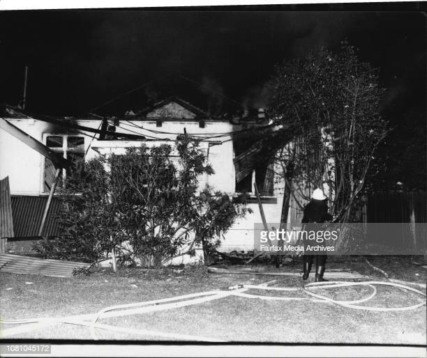 Fireman mop up after a fire which gutted Rockdale Laundry in Cecil St Hurstville There was nobody injured in the fire February 27 1981