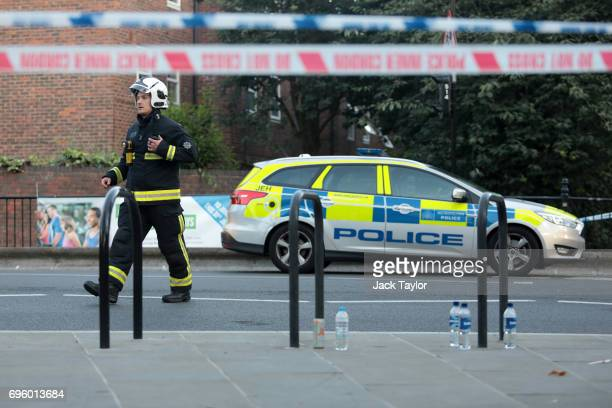 A fireman near the 24 storey residential Grenfell Tower block in Latimer Road West London on June 14 2017 in London England The Mayor of London Sadiq...