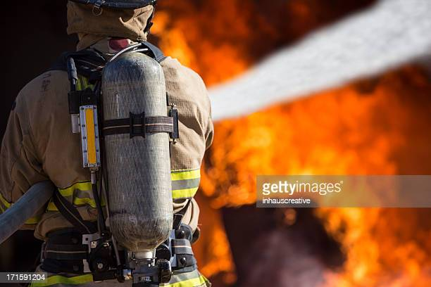 Fireman putting out a bedroom fire