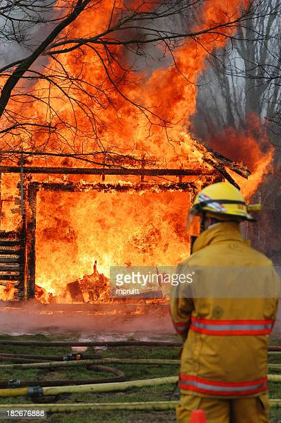 Fireman putting out large house fire