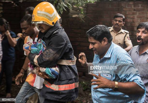 Fireman rescue 3 months old dead baby after a fourstorey building Sai Darshan collapsed fourteen fire engines one rescue van and an ambulance have...