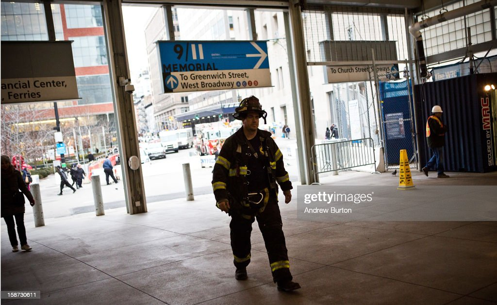 A fireman responds to a two-alarm fire at the World Trade Center on December 26, 2012 in New York City. The fire, which broke out in the construction trailers surrounding the World Trade Center building, was quickly contained.