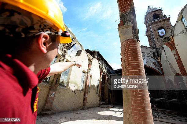Fireman Salvatore Cardaci coordinator of works shows parts of the damaged church in Mirandola on May 22 2013 a year after an earthquake in the Emilia...