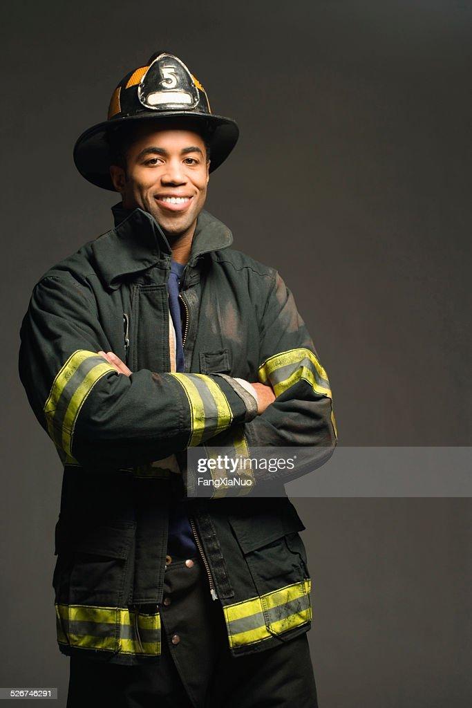 Fireman Smiling On Black Background Portrait Stock Photo