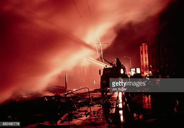 fireman spraying fire - loma prieta earthquake stock pictures, royalty-free photos & images