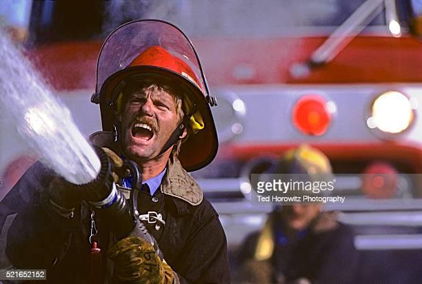 Fireman Spraying Hose
