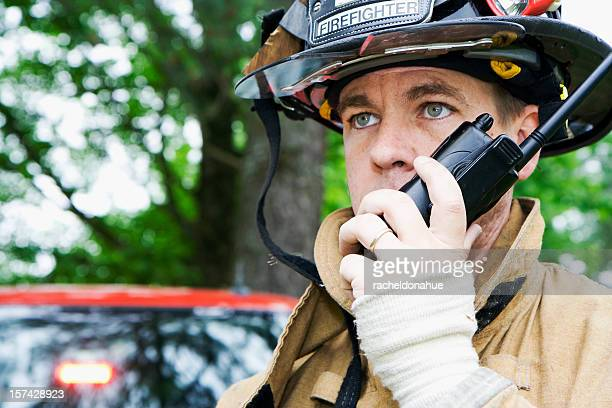 fireman talking on radio - rescue worker stock pictures, royalty-free photos & images