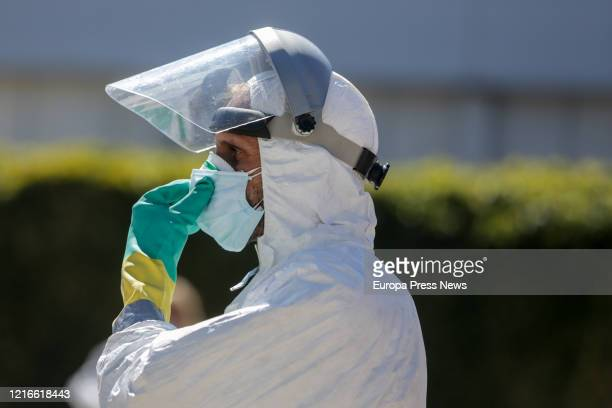 A fireman that has been disinfecting ambulances is seen at the campaign hospital of IFEMA established to help during the infection admitting...