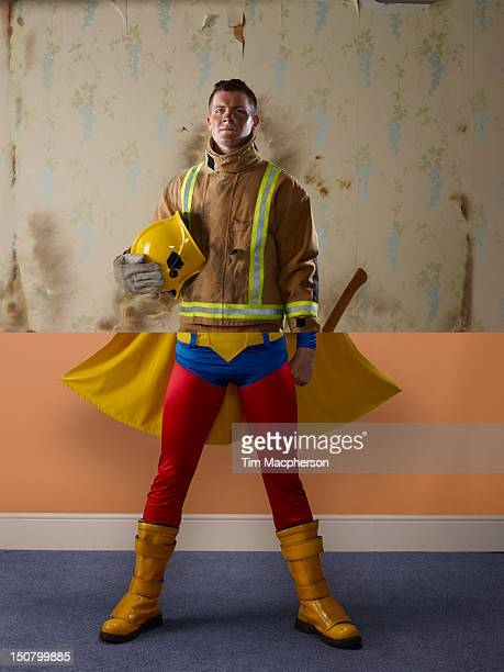 fireman top, super hero bottom - heroes stock pictures, royalty-free photos & images