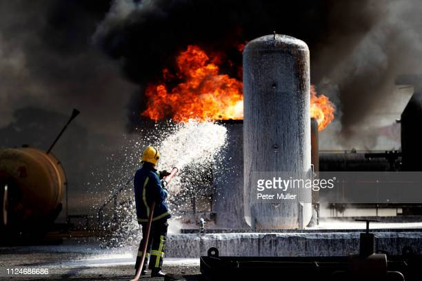 fireman training to put out fire on burning tanks, darlington, uk - extinguishing stock pictures, royalty-free photos & images