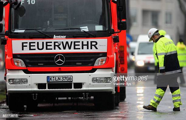 A fireman waits next to his car during the clean up the ruine of the building of the Historical Archive of the City of Cologne on March 6 2009 in...