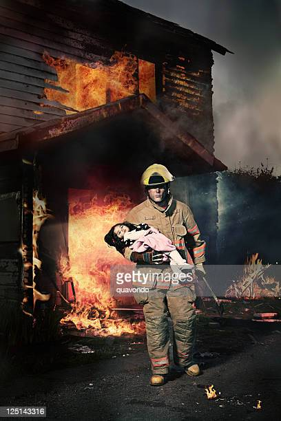 baby girl rescued from burning house by fireman - rescue stock pictures, royalty-free photos & images