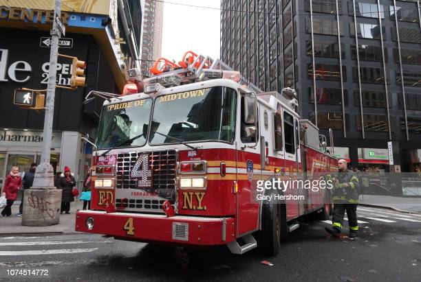 A fireman walks back to an FDNY fire engine as it tries to make a turn onto Broadway on November 28 in New York City