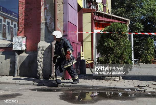 A fireman walks next to the Tokyo Star hotel in Odessa southern Ukraine on August 17 2019 after a fire broke out overnight Eight people were killed...