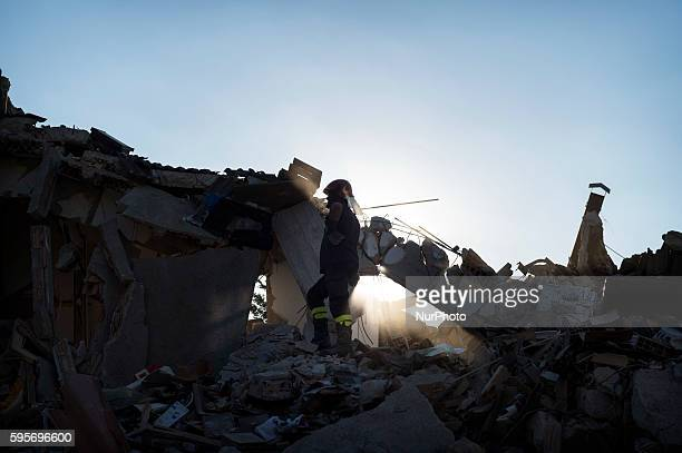 Fireman walks on rubbles in Amatrice, Italy, on August 24, 2016. A powerful pre-dawn earthquake devastated mountain villages in central Italy on...