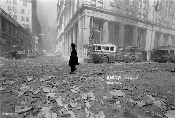 A fireman walks through rubble covering the intersection of Broadway and John Street in downtown Manhattan The World Trade Center in New York City...