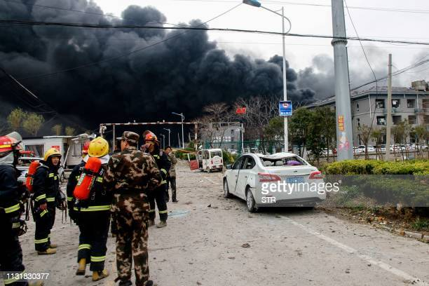 TOPSHOT Firemen and Chinese paramilitary police officers search at an explosion site in Yancheng in China's eastern Jiangsu province on March 21 2019...