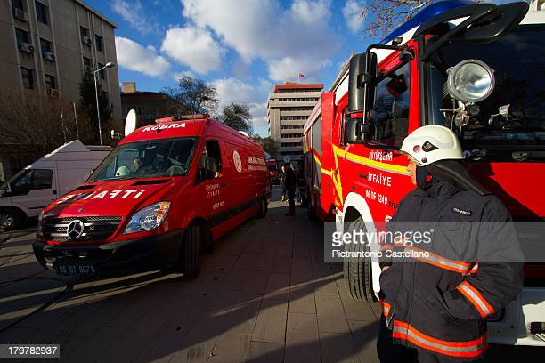 Firemen and emergency vehicles deployed at U.S. Embassy in Ankara, Turkey, after a suicide bomber killed himself, a security guard on February 1,...