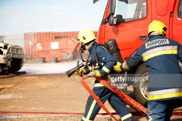 firemen and fire engine in training centre, darlington, uk - hose stock pictures, royalty-free photos & images