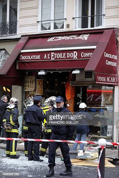 Firemen and policemen gather for rescuing operations at the site of a blast that occurred at chocolate shop 'A l'Etoile d'Or' in the Paris 9th...