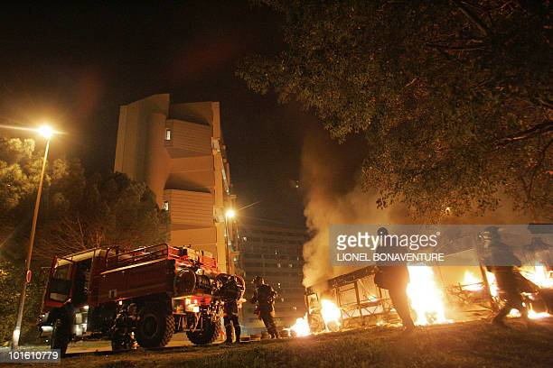 "Firemen are at work as a bus is burning at the entrance of ""Le Mirail"", a sensitive neighbourghood of Toulouse, west southern France, 07 November..."
