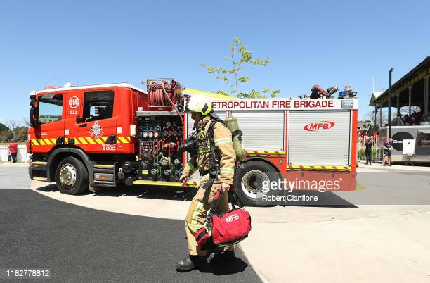 Firemen arrive after a fire alarm stopped play during the Women's Big Bash League match between the Melbourne Renegades and the Perth Scorchers at...