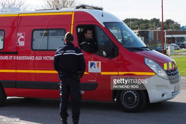 Firemen arrive at the Super U supermarket of Trebes southern France on March 23 after special forces killed a gunman who had taken several people...