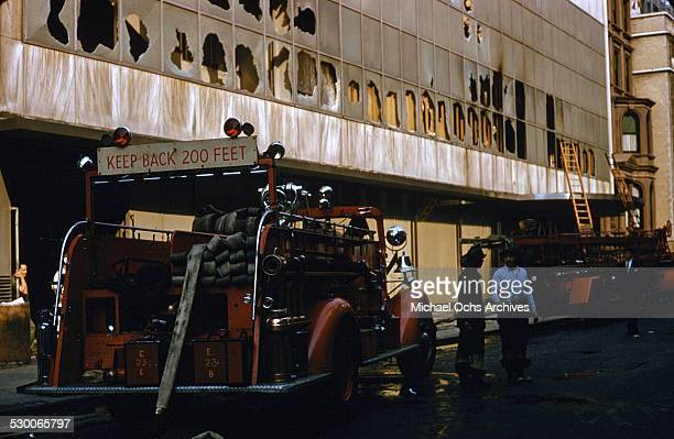 Firemen assess the damage after a fire broke out on the second floor of the Museum of Modern Art in New York, NY.