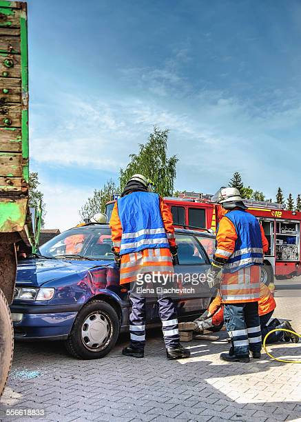 Firemen at car accident scene
