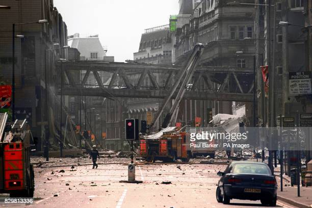 Firemen at the scene of the IRA bomb blast in Manchester city centre