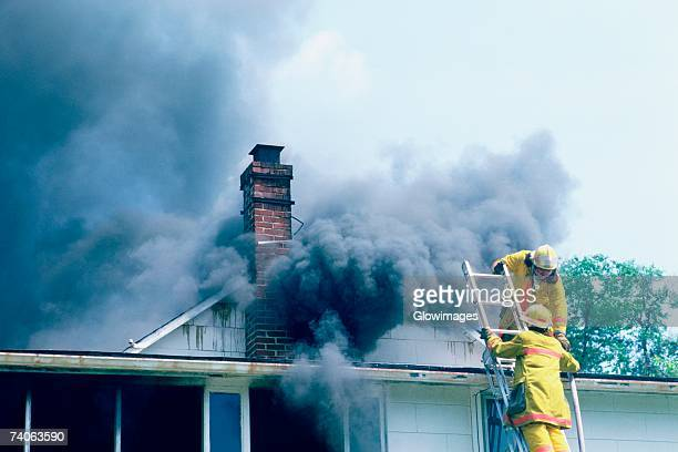 Firemen at work on a burning house in Maryland
