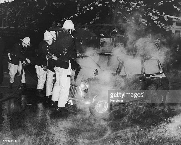 Firemen attend a burning car on the second day of riots in Brixton London 13th April 1981