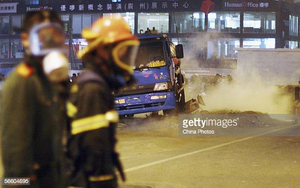 Firemen attend the scene of a hydrochloric acid spill at the Chepi Road on January 16 2006 in Guangzhou of Guangdong Province China A truck carrying...