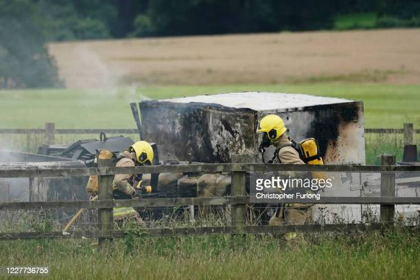 Firemen attend to a lorry fire causing the closure of the M6 motorway on July 22 2020 in Knutsford England
