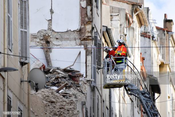 TOPSHOT Firemen check a building on Aubagne's street in Marseille southern France on November 8 following the collapse of two buildings earlier...